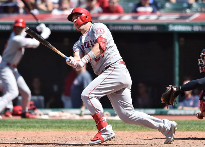 Aug 4, 2019; Cleveland, OH, USA; Los Angeles Angels center fielder Mike Trout (27) hits a double during the sixth inning against the Cleveland Indians at Progressive Field. Mandatory Credit: Ken Blaze-USA TODAY Sports