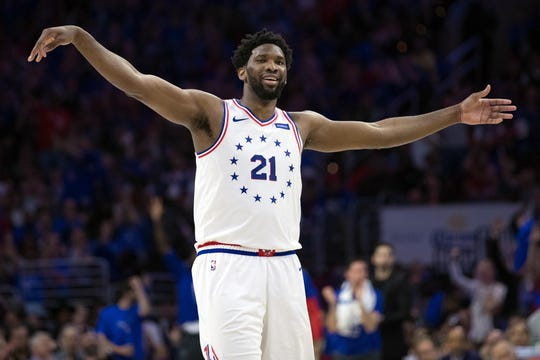 Center Joel Embiid (21) will be leading the Philadelphia 76ers into action when the team hosts Milwaukee on Christmas.