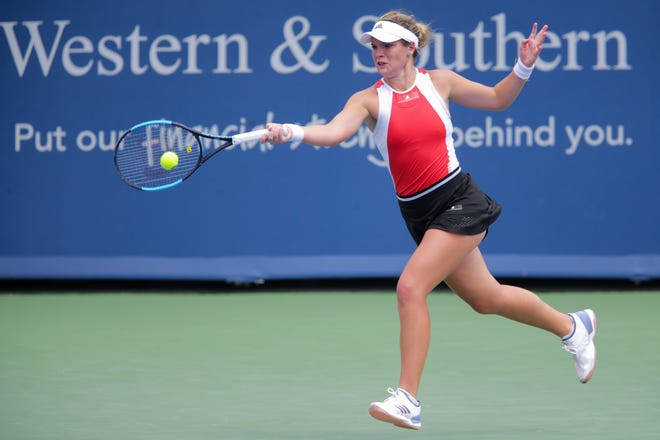 Caty McNally, of the United States, returns a shot against Elise Mertens, of Belgium, during a first-round match of the Western & Southern Open tennis tournament, Monday, Aug. 12, 2019, at the Lindner Family Tennis Center in Mason, Ohio.