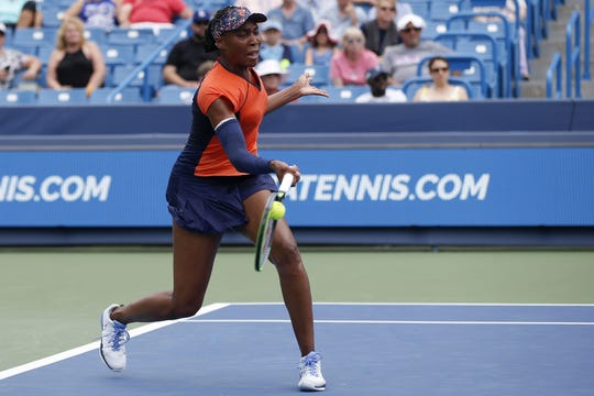 Venus Williams, of the United States, returns a shot against Lauren Davis, of the United States, during a first-round match of the Western & Southern Open tennis tournament, Monday, Aug. 12, 2019, at the Lindner Family Tennis Center in Mason, Ohio.
