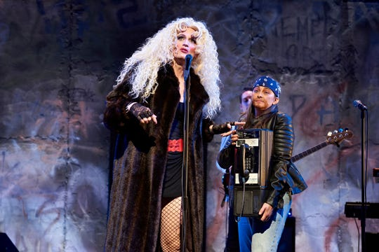 "Beth Harris, right, is seen here in the role of Yitzhak, along with Todd Almond, center, as Hedwig in Ensemble Theatre Cincinnati's 2018 production of ""Hedwig and the Angry Inch."" Harris will be seen Aug. 16-24 in Memorial Hall's production of ""Ring of Fire: The Music of Johnny Cash."""