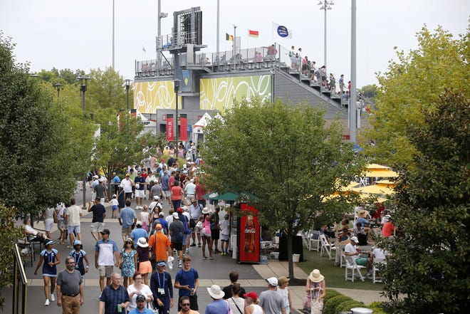 Tennis fans walk through the Lindner Family Tennis Center during first-round matches of the Western & Southern Open tennis tournament, Monday, Aug. 12, 2019, in Mason, Ohio.