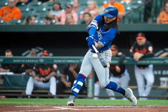 Aug 2, 2019; Baltimore, MD, USA;  Toronto Blue Jays second baseman Freddy Galvis (16) hits a RBI single in the first inning against the Baltimore Orioles at Oriole Park at Camden Yards. Mandatory Credit: Tommy Gilligan-USA TODAY Sports