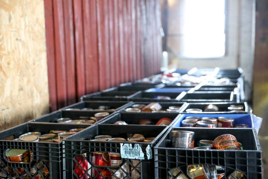 Countless containers hold canned goods Manna Cafe Ministries will be using in its new, larger site at the future site of Manna Village in Clarksville, Tenn., on Monday, Aug. 12, 2019.