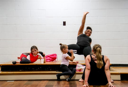 Alivia Morris, 13, center right, practices a move with fellow dancers Kaylynn Jones, 8, from left, Maddie Fryer, 6, and Jaela Fanokos, 13, at Infinity Dance Fitness Academy in Clarksville on July 25, 2019.