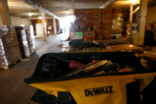 An open Dewalt bag holds equipment used in the transition and renovation at the future site of Manna Village in Clarksville, Tenn., on Monday, Aug. 12, 2019.