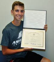 Caleb Shriver of Warsaw holds his certificate for completing the U.S. Senate Page Program. Shriver said he was inspired by his experience and may one day run for office.