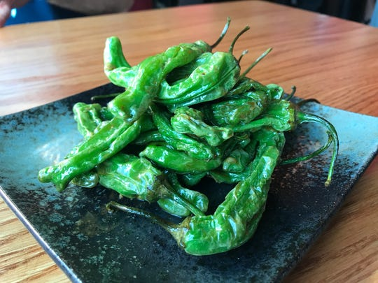 Grilled shishito peppers from Wasabi Ankeny.