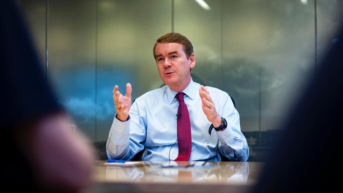 Iowa caucuses: Michael Bennet wants to raise the minimum wage to $15 in parts of US, expand tax credits