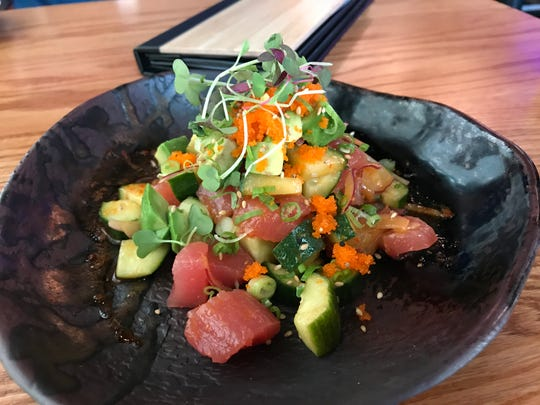 Tuna Poke - Chopped tuna with cucumber, onion, masago (fish eggs) and avocado with a spicy sesame dressing from Wasabi Ankeny.