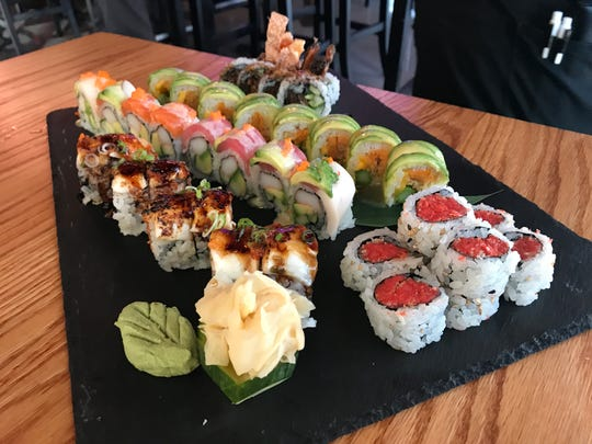 A combination of rolls from Wasabi Ankeny (l to r) - Marilyn Monroll ($15), Honey Rainbow Roll ($13), Green Peace ($12), Crispy Salmon Skin ($6) and Spicy Tuna ($7)