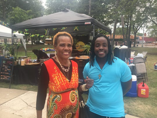 Nathan Baptiste, 35, of Belleville and his mother, Merinne Baptiste, 74, of Highland Park attend the 40th annual Caribbean Cultural Festival at City Hall Park in Dearborn Sunday.