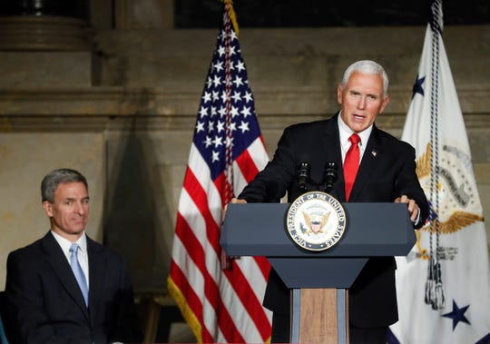 In this July 4, 2019 photo, Vice President Mike Pence speaks at a naturalization ceremony for new naturalized citizens in celebration of Independence Day at the National Archives in Washington.