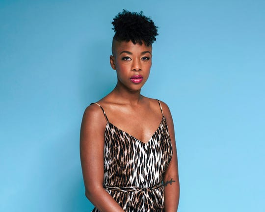 "FILE - This June 28, 2019, photo shows Samira Wiley posing for a portrait in New York to promote the seventh season of ""Orange is the New Black.""  Wiley has some advice for us all: ""Find something that you love to do and get somebody to pay you for it."" Wiley told The Associated Press her love of acting is like an addiction, but it wasn't until she attended Juilliard that she realized it could be a living.  (Photo by Christopher Smith/Invision/AP)"