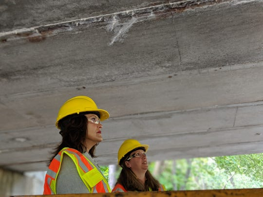 Gov. Gretchen Whitmer inspects a deteriorating bridge in Lansing on Aug. 12, 2019.