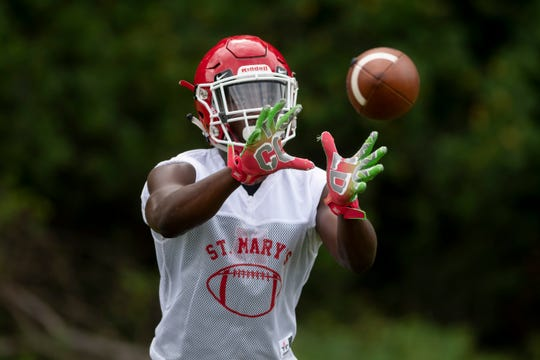 Kameron Arnold catches a pass during the Orchard Lake St. Mary's practice Monday.