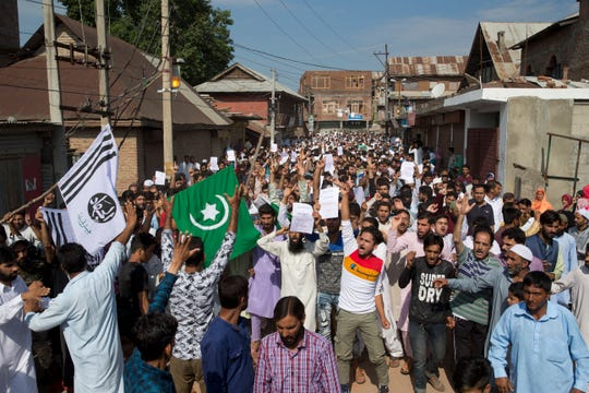 Kashmiri Muslims shout slogans during a protest after Eid prayers during a security lockdown in Srinagar, Indian controlled Kashmir, Monday.