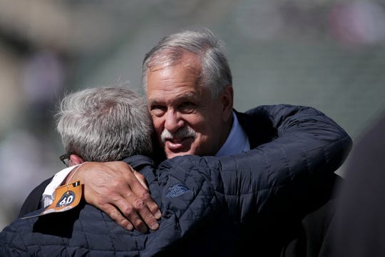 Matt Millen greets a friend before the Raiders play the Rams last week in Oakland.