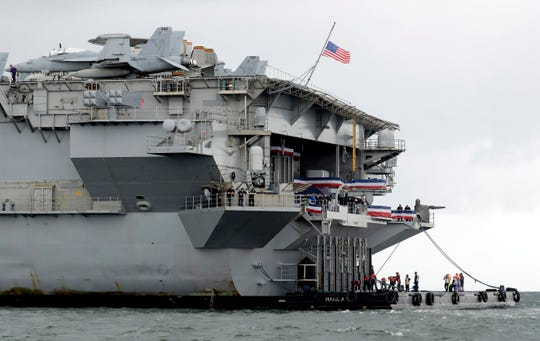 The U.S. aircraft carrier USS Ronald Reagan is anchored off Manila Bay, Philippines, for a port call Wednesday, Aug. 7, 2019.