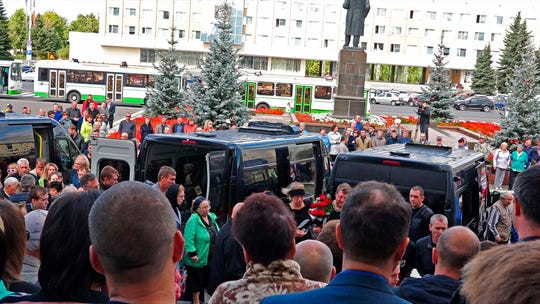 In this grab taken from a footage provided by the Russian State Atomic Energy Corporation ROSATOM press service, people gather for the funerals of five Russian nuclear engineers killed by a rocket explosion in Sarov, the closed city, located 370 kilometers (230 miles) east of Moscow, Monday, Aug. 12, 2019.