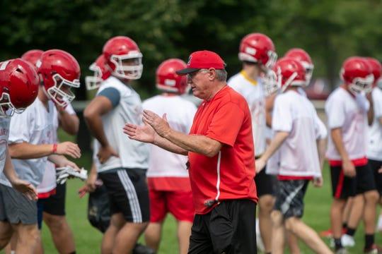 Orchard Lake St. Mary's Preparatory high school football head coach George Porritt keeps an eye on his team during practice.