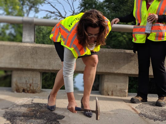 Gov. Gretchen Whitmer tests the integrity of a Lansing bridge on Aug. 12, 2019.
