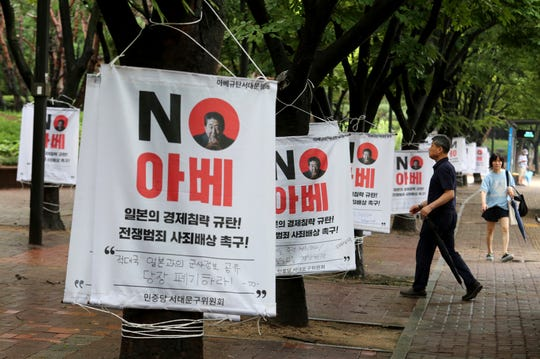 Banners with image of Japanese Prime Minister Shinzo Abe are displayed to denounce Japan's trade restrictions on South Korea on a street in Seoul, South Korea, Monday, Aug 12, 2019.