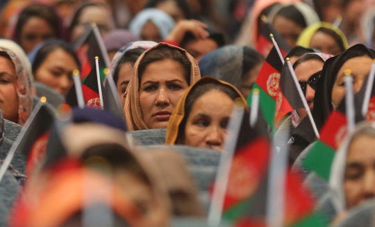 Afghan women attends an election campaign rally by Afghan presidential candidate Ashraf Ghani, in Kabul, Afghanistan, Monday, Aug. 5, 2019.