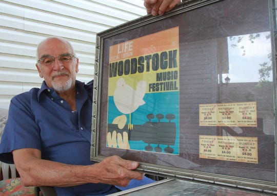 Charles Vestrand, Drums, Pa., displays his framed Life special edition Woodstock magazine along with his tickets from the 1969 music festival, Friday Aug. 9, 2019. The historic Woodstock music festival has its fiftieth anniversary this month. (Warren Ruda/Hazleton Standard-Speaker via AP)