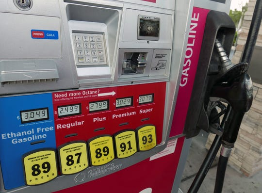 In this Wednesday, June 26, 2019 photo, various fuel prices are displayed on a pump at a gas station in Orlando, Fla.