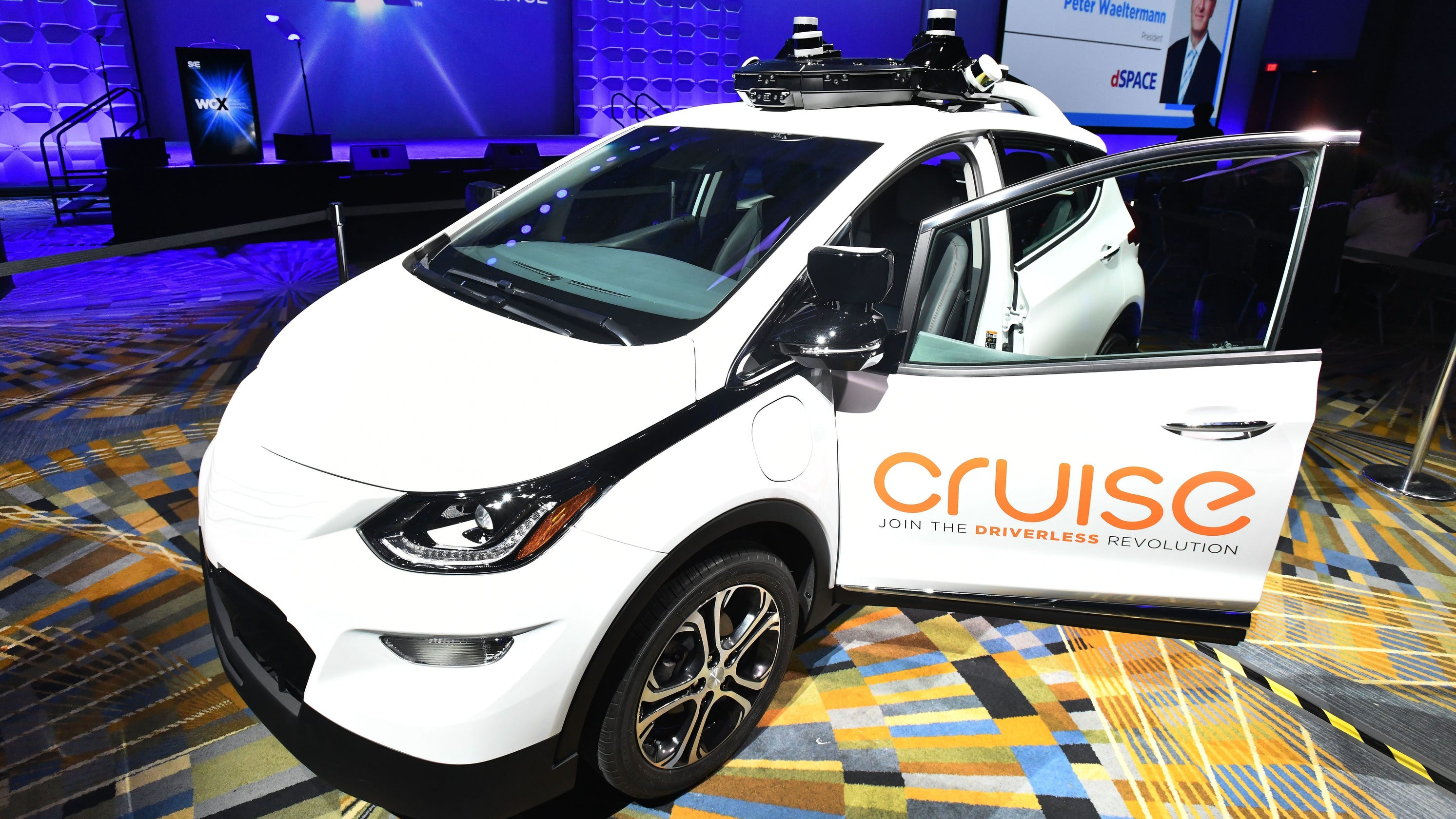 Robot cars drive forward without clear direction from Washington