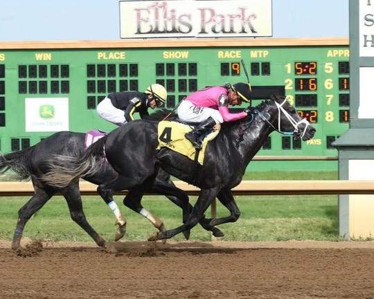 Corey Lanerie had to work hard to get favored Gray Magician past Knicks Go in Sunday's $100,000 Ellis Park Derby.