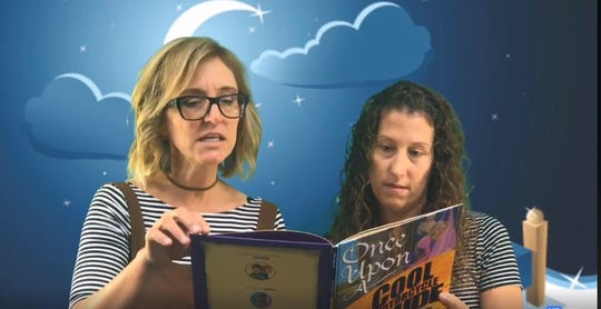 "Riverside Elementary School teachers Heather Meier and Heather Rathman read ""Once Upon a Cool Motorcyle Dude"" for the school's weekly ""Goodnight Riverside"" story featured on its Facebook page: Riverside Rockets."
