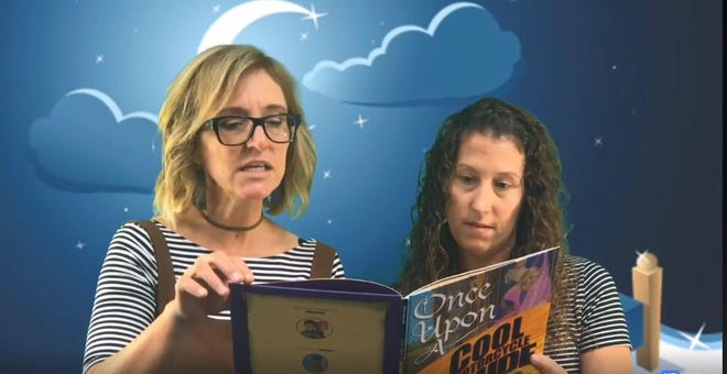 """Riverside Elementary School teachers Heather Meier and Heather Rathman read """"Once Upon a Cool Motorcyle Dude"""" for the school's weekly """"Goodnight Riverside"""" story featured on its Facebook page: Riverside Rockets."""