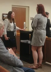 Morgan Skau, right, waits with her lawyer for paperwork after sentencing on Monday, Aug. 12, 2019. Judge H. Andrew Swett gave her six months probation, a $500 fine and 300 hours of community service - the most he could give her under sentencing laws. She was charged with a second-degree misdemeanor for allowing an unlicensed driver to operate her truck. Jill Mandeville died when Brett Pelham, going twice the legal speed limit blew a stop sign, police reports say.