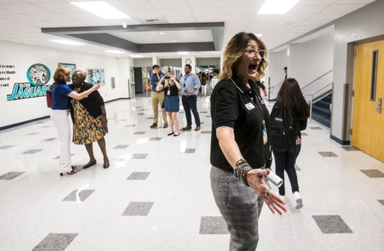Melissa Robery, the principal of East Lee High School in Lehigh Acres greets students on the first day of school on Monday, August, 12, 2019. The school increased its grade from a D to C which means it comes out DA status or Differentiated Accountability.