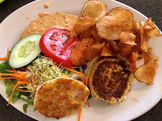 A crab cake sandwich with house-made potato chips from Crave in south Fort Myers.