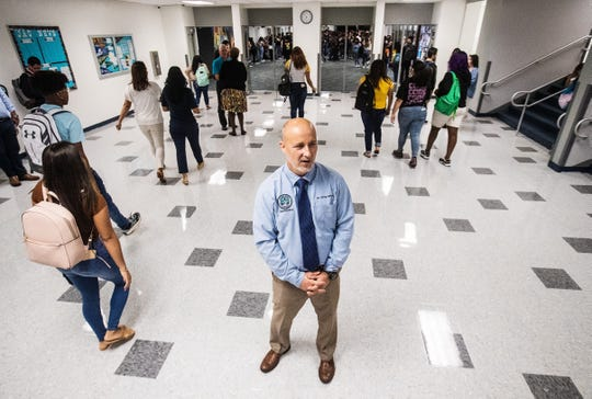 "Greg Adkins, the superintendent for Lee County Schools greets students on the first day of school at East Lee High School on Monday, August, 12, 2019. The school increased its grade from a ""D"" to ""C"" which means it comes out DA status or Differentiated Accountability. He was there to congratulate the school on the accomplishment."