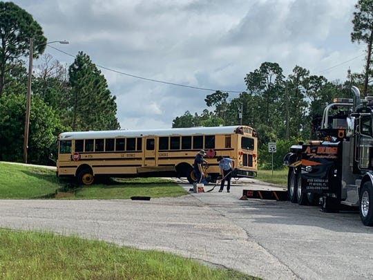 A crash between a school bus and a pickup truck along a Lehigh Acres road resulted in several injuries Monday, the first day of classes for Lee County students.