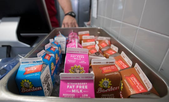 A variety of dairy milks are in a tray at Cape Coral High School in August 2019.