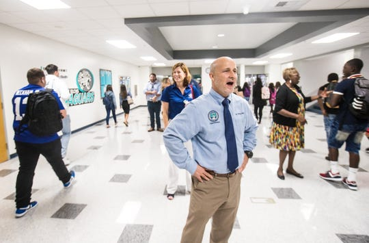 """Lee County schools superintendent Greg Adkins greets students on the first day of school at East Lee High School on Monday. The school increased its grade from a """"D"""" to """"C"""" on the statewide report card. He was there to congratulate the school on the accomplishment."""