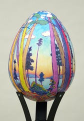 """""""Chorus by the Shore,"""" acrylic on molded form by Lynn Gilchrist, is one of 28 artist-created eggs that were part of Egg Harbor's summer community art project. The eggs are up for bids Saturday night during the EGGstravaganza Gala Auction."""