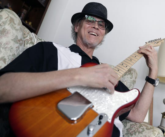 Dan Thimm, who is in remission after being diagnosed with  cancer in 2018, sits in the living room of his Sturgeon Bay home on Feb. 26, 2019, with a guitar he made.