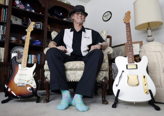 Dan Thimm, who is in remission after being diagnosed with  cancer in 2018, sits in the living room of his Sturgeon Bay home on Feb. 26, 2019, with two guitars he made.