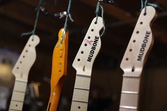 Custom-cut guitar headstocks hang in the workshop of Dan Thimm's Sturgeon Bay residence on Feb. 26, 2019.n