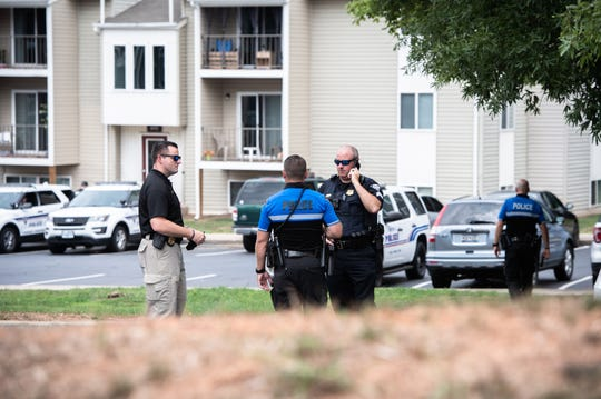 Greenville police officers work the scene where a hostage situation took place Monday afternoon, ending in the arrest of one individual August, 12, 2019.