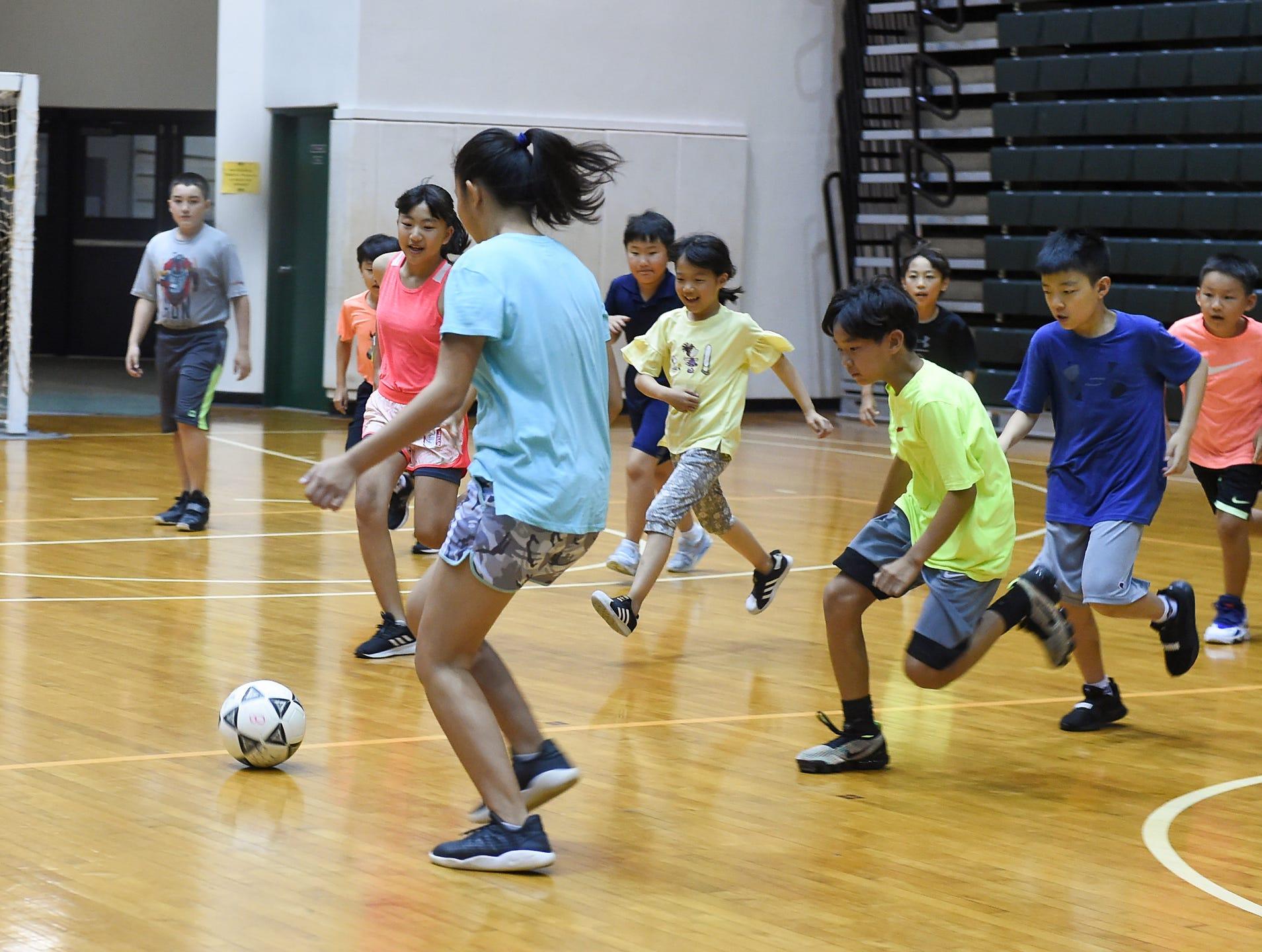 Kids get a soccer workout at UOG Adventure Sports Camp
