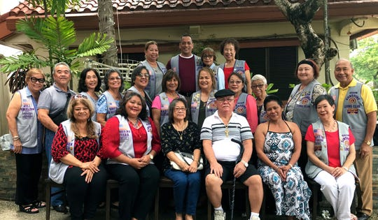 The Guam Sunshine Lions Club presented monetary donations to assist with the medical treatment expenses on July 20 at the Chamorro Village. Seated from left: LouJean Borja, Lorraine Rivera, Emily Palacios, 72, of Agat, (recipient), Antonio Palacios, 75, of Agat (recipient), Evangeline Taimanglo, 48, of Talofofo, (recipient) and Marietta Camacho. Second row: Jill Pangelinan, Johnny Villagomez, Linda Villagomez, Dot Leon Guerrero, Dee Cruz, Mary Taitano, Juiie Cruz, Marie Salas, Jovie Mejorada, Doris Cruz, and Pete Babauta. Back row: Lions Clarice Quichocho, Frank Aguon, Jr., Sid Weedin, and Tiger Kim.