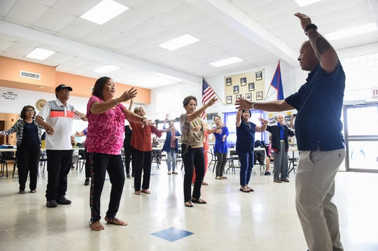 Dance instructor Delbert Calvo, right, guides manamko' during a cultural dance lesson as part of a Color Guam outreach program at the Tamuning Senior Citizen Center, Aug. 12, 2019. Recently, the organization received a loan from Guam CAHA and have since been trying to bring more activities to senior centers throughout the island.