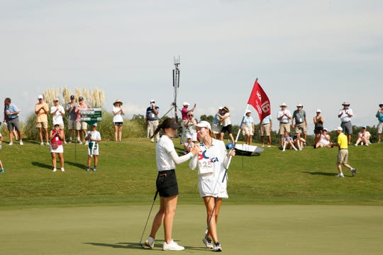 Gabriela Ruffels is congratulated by her caddie after she sunk her putt to win the final round at the 2019 U.S. Women's Amateur at Old Waverly Golf Club in West Point, Miss. on Sunday, Aug. 11, 2019.  (Copyright USGA/Steven Gibbons)